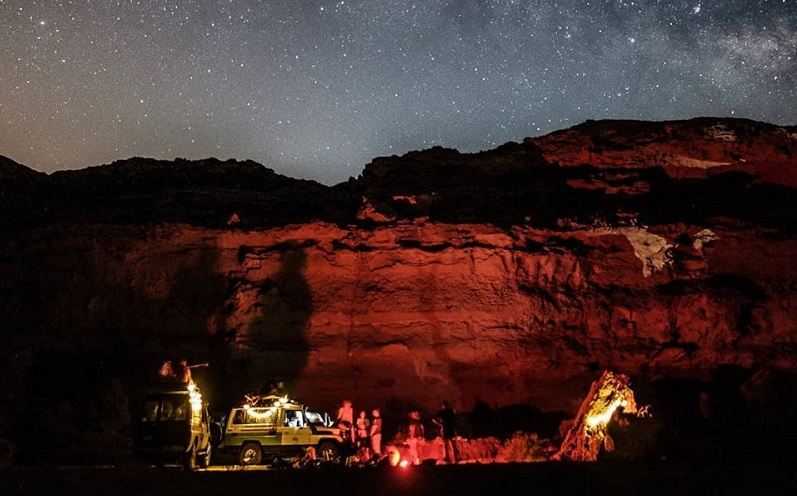 El Gouna Mountain Goats with 4X4 cars at the heart of El Gouna Red Sea mountains covered by the clear starry sky