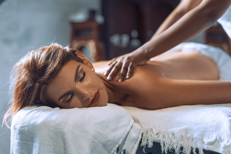 A lady feeling relaxed during a massage session at El Gouna hotels luxury spas