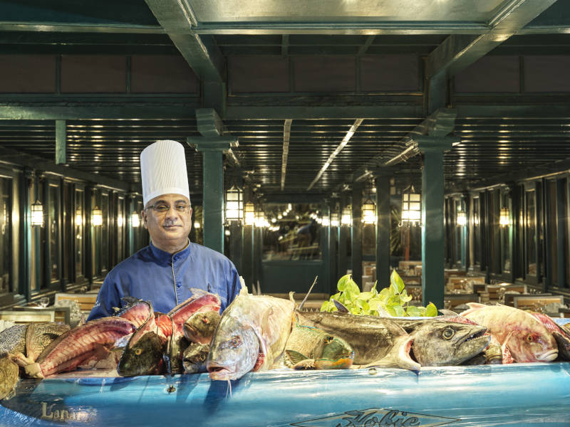 a fresh red sea fish corner and a chef at marco polo's restaurant in club paradisio el gouna resort