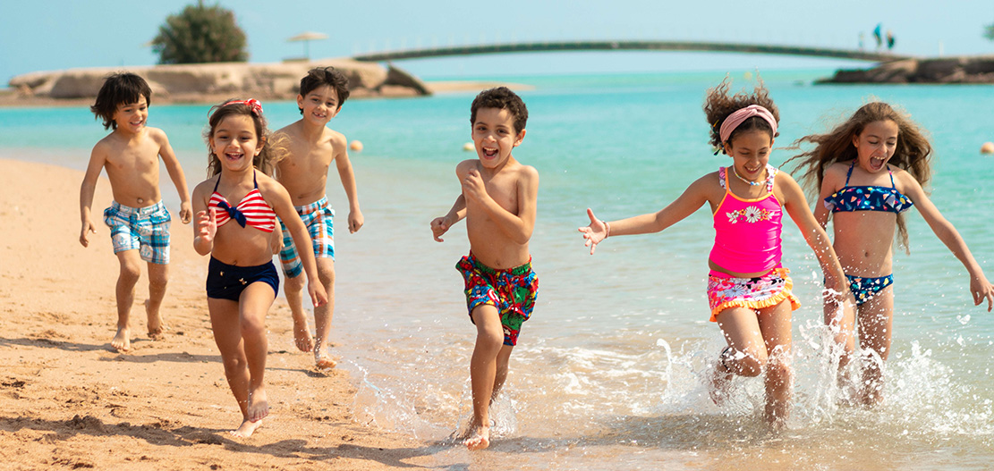 Kids are playing along the shores of Red Sea in El Gouna at Movenpick Resort