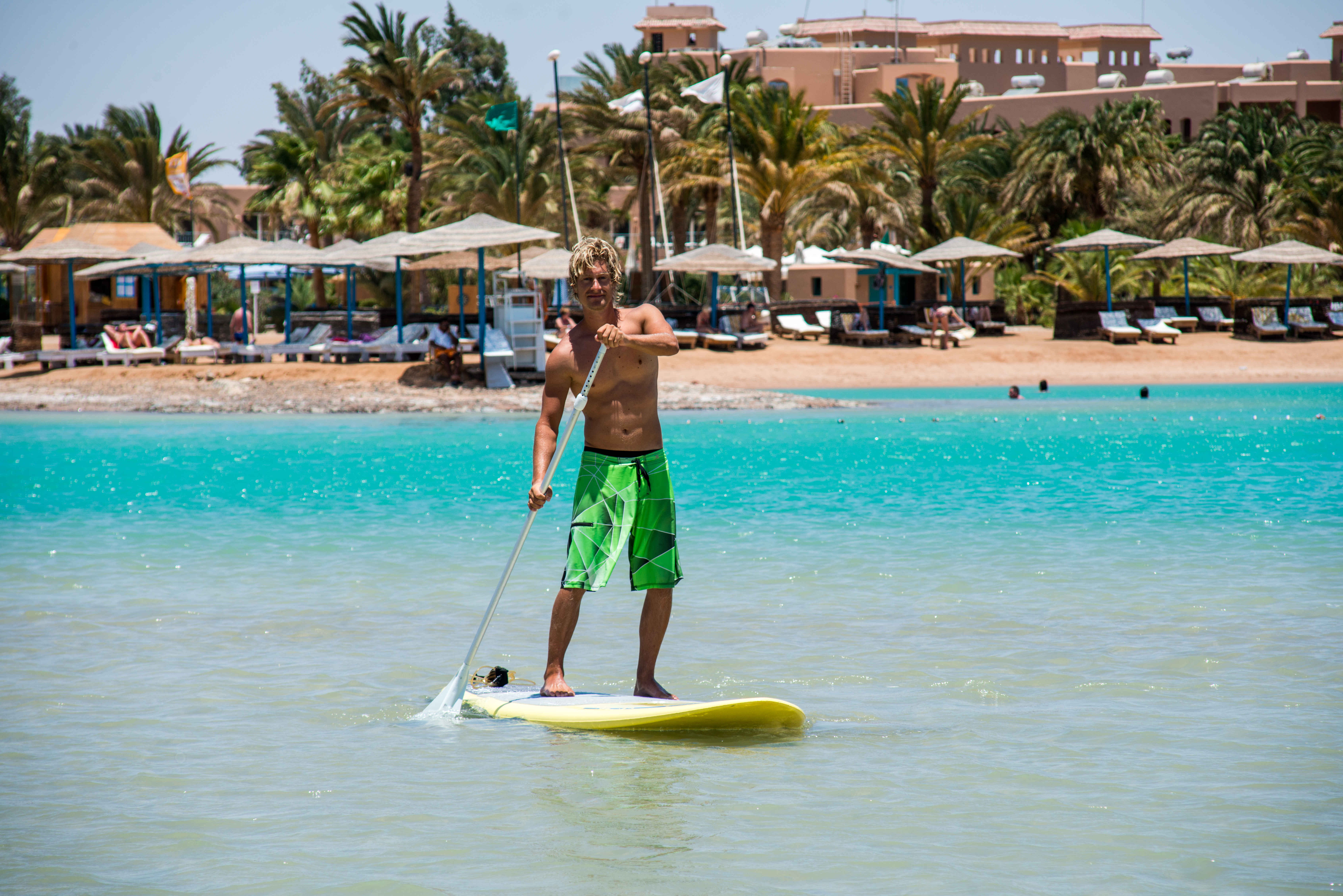 A guy is stand up paddling in Labranda Club Paradisio Hotel in Red Sea El Gouna