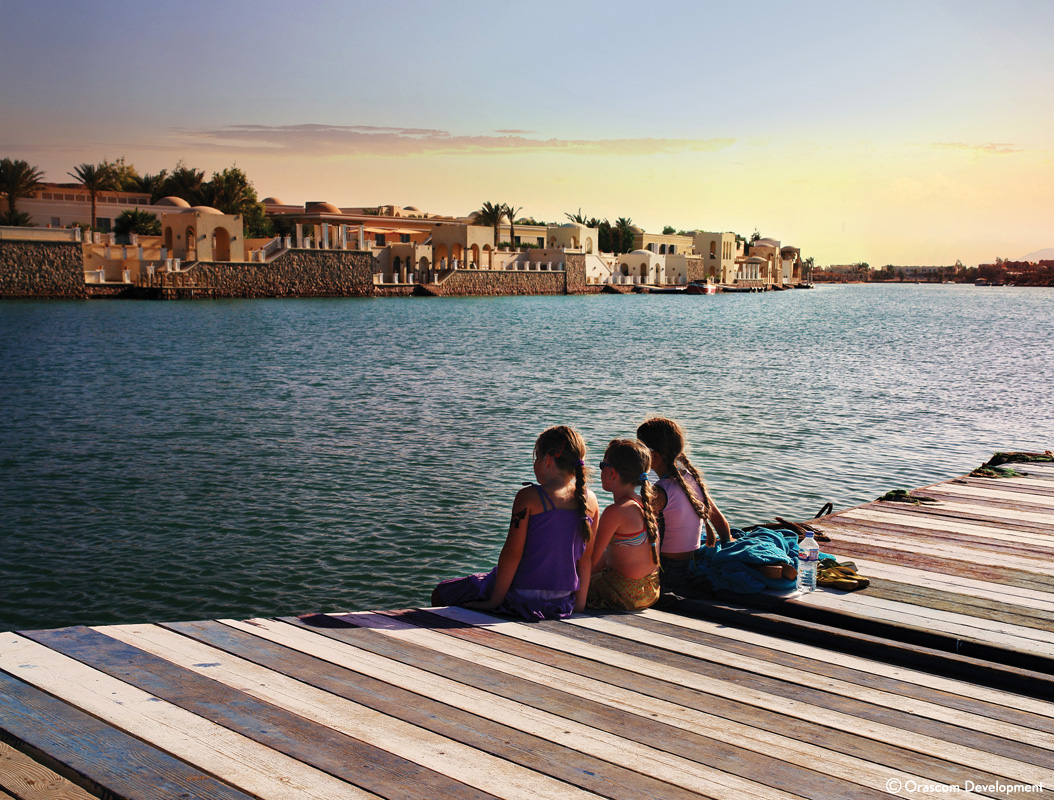 kids seating on the beach of el gouna red sea town