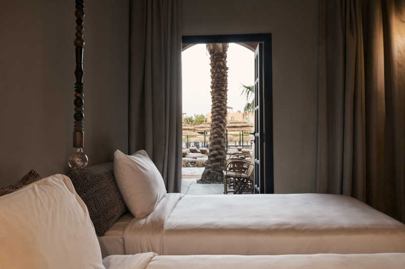 twin bed room with pool view at cook's club el gouna hotel