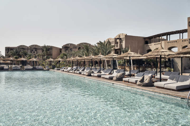 pool area and seatings in cook's club hotel el gouna