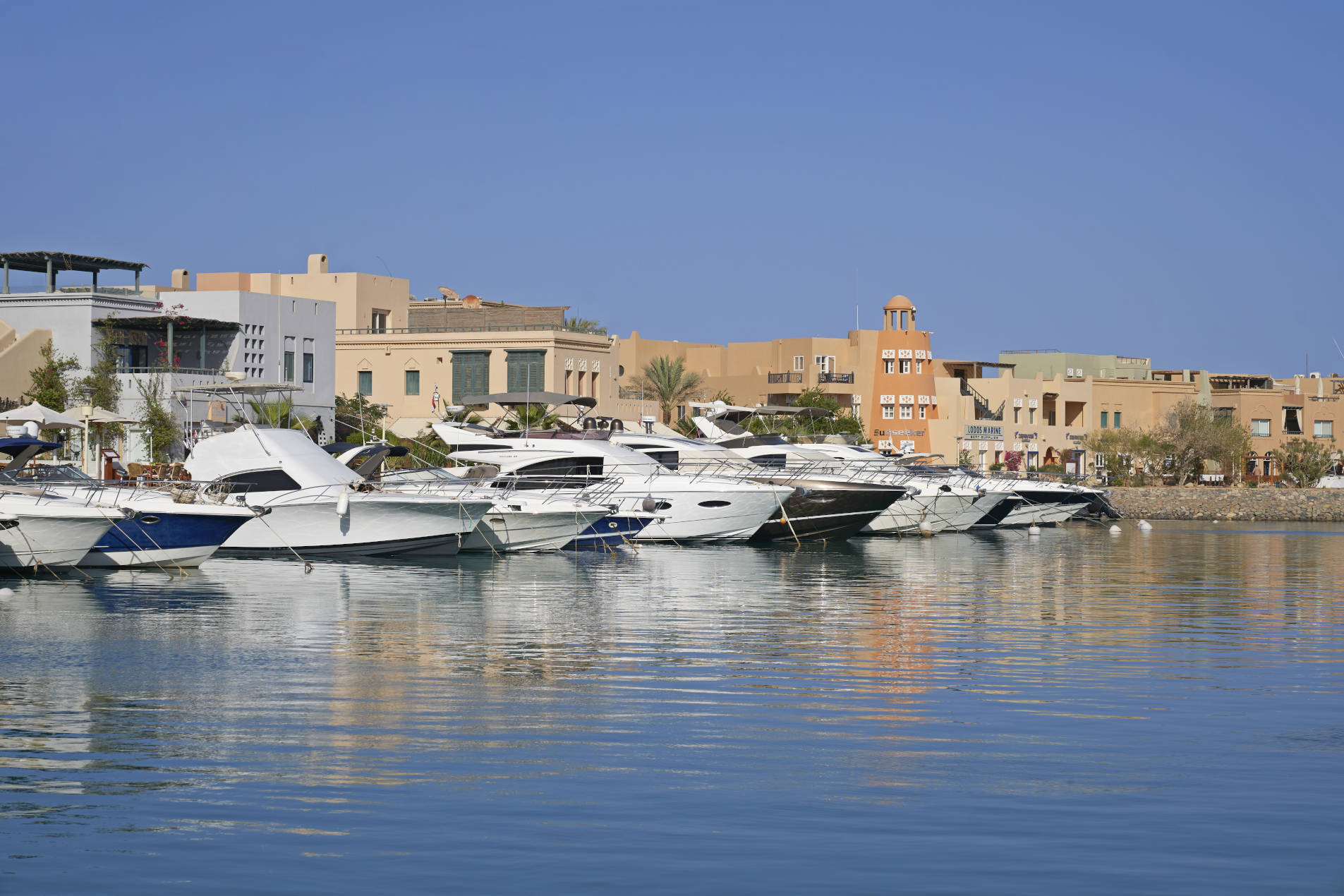 Daytime view of Abu Tig Marina El Gouna from Turtle's Inn Marina view room terrace showing orderly parked yachts & redsea