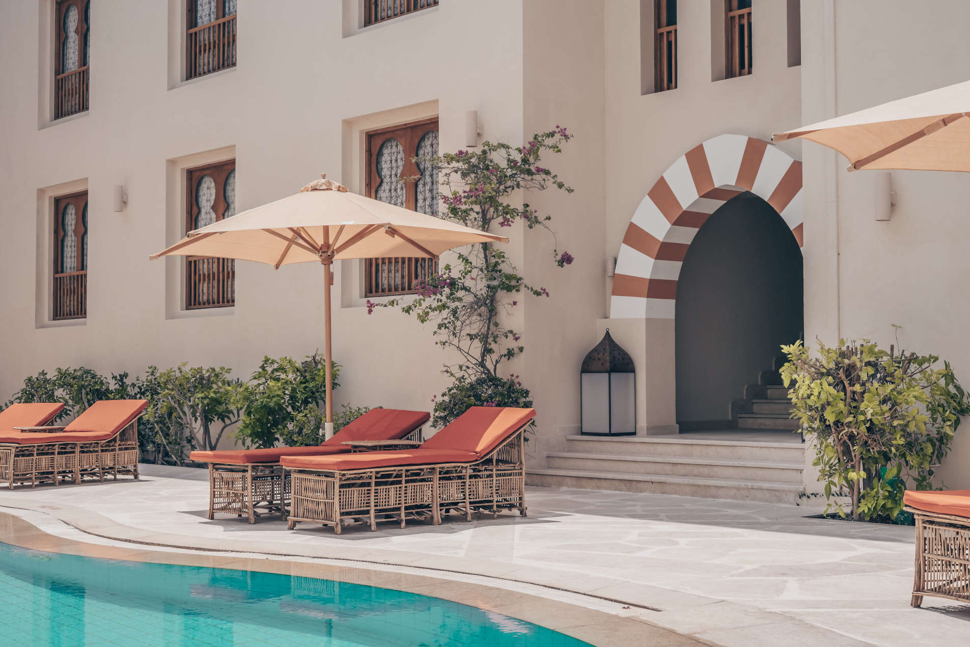 The swimming pool, chaise lounges and Umbrellas of Ali Pasha The s star Hotel in Marina Abu Tig El Gouna Red Sea Egypt