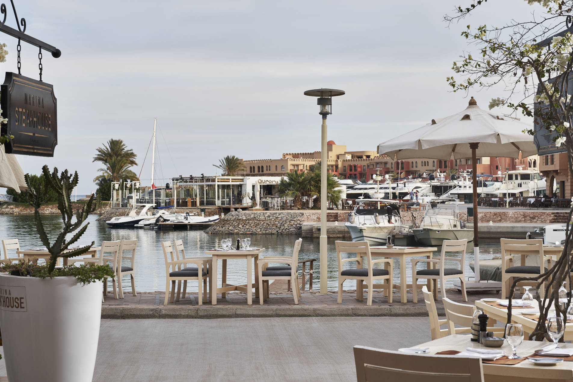Outdoor Marina Sitting area of The Marina Steakhouse , the restaurant of Turtle's Inn and Captain's Inn Hotels