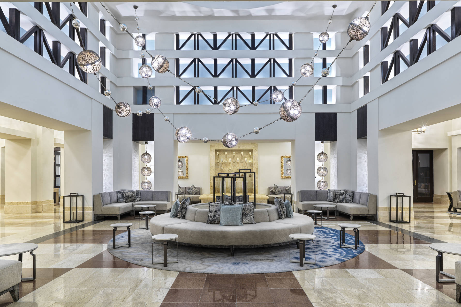 The lobby area with round sofa and authentic deocration of Sheraton Miramar El Gouna 5 stars hotel