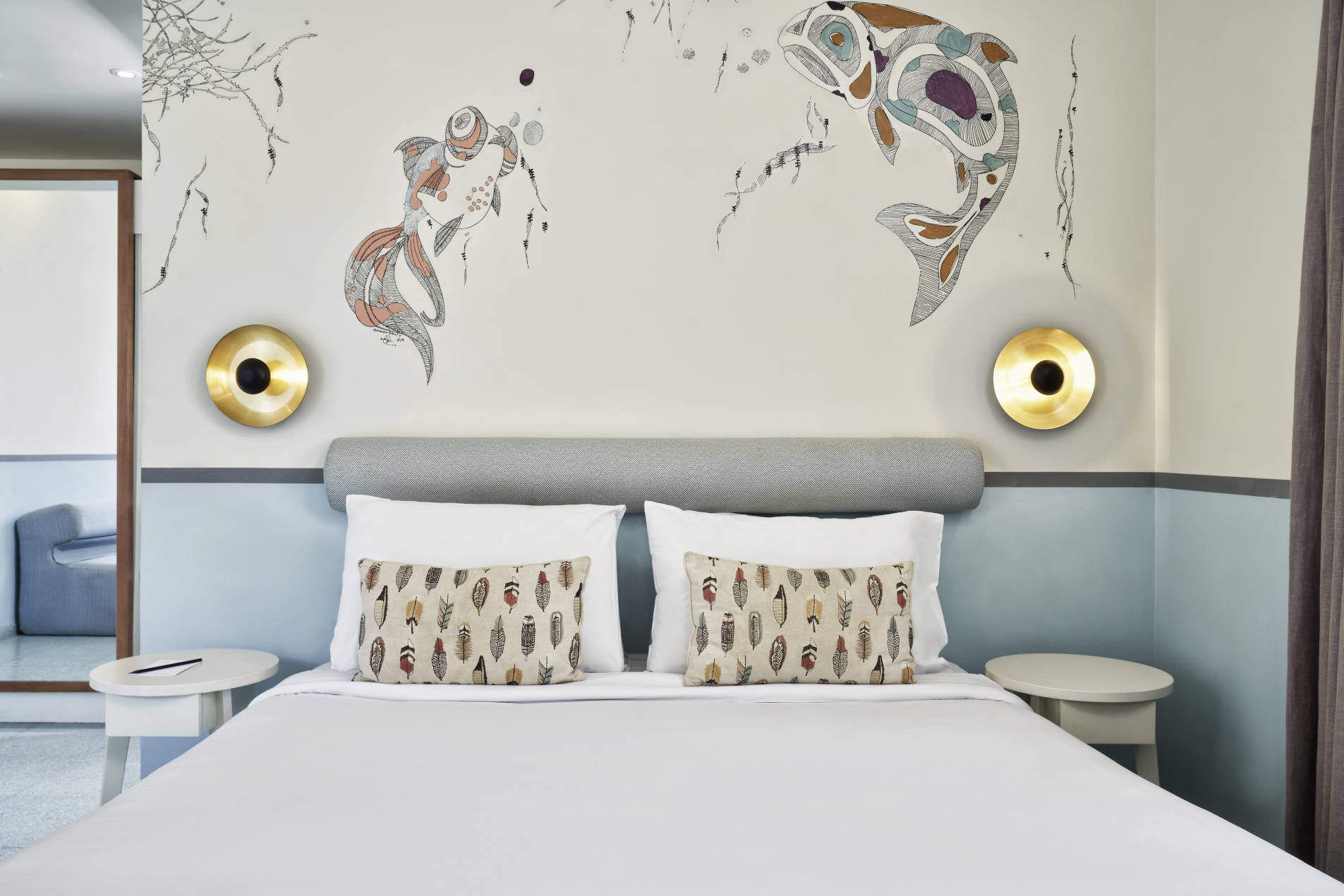 Water Theme Room in Turtle's Inn Hotel El Gouna Egypt with King size bed & two cushions with bohemian design feathers casing