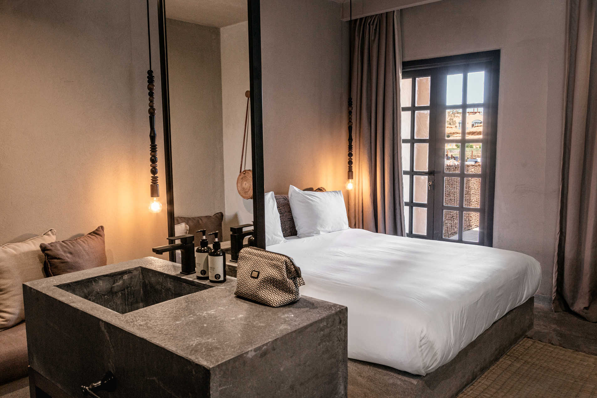The kingbed room in Cook's Club with luxury beddings and a french door with a mirror for El Gouna luxury accommodation