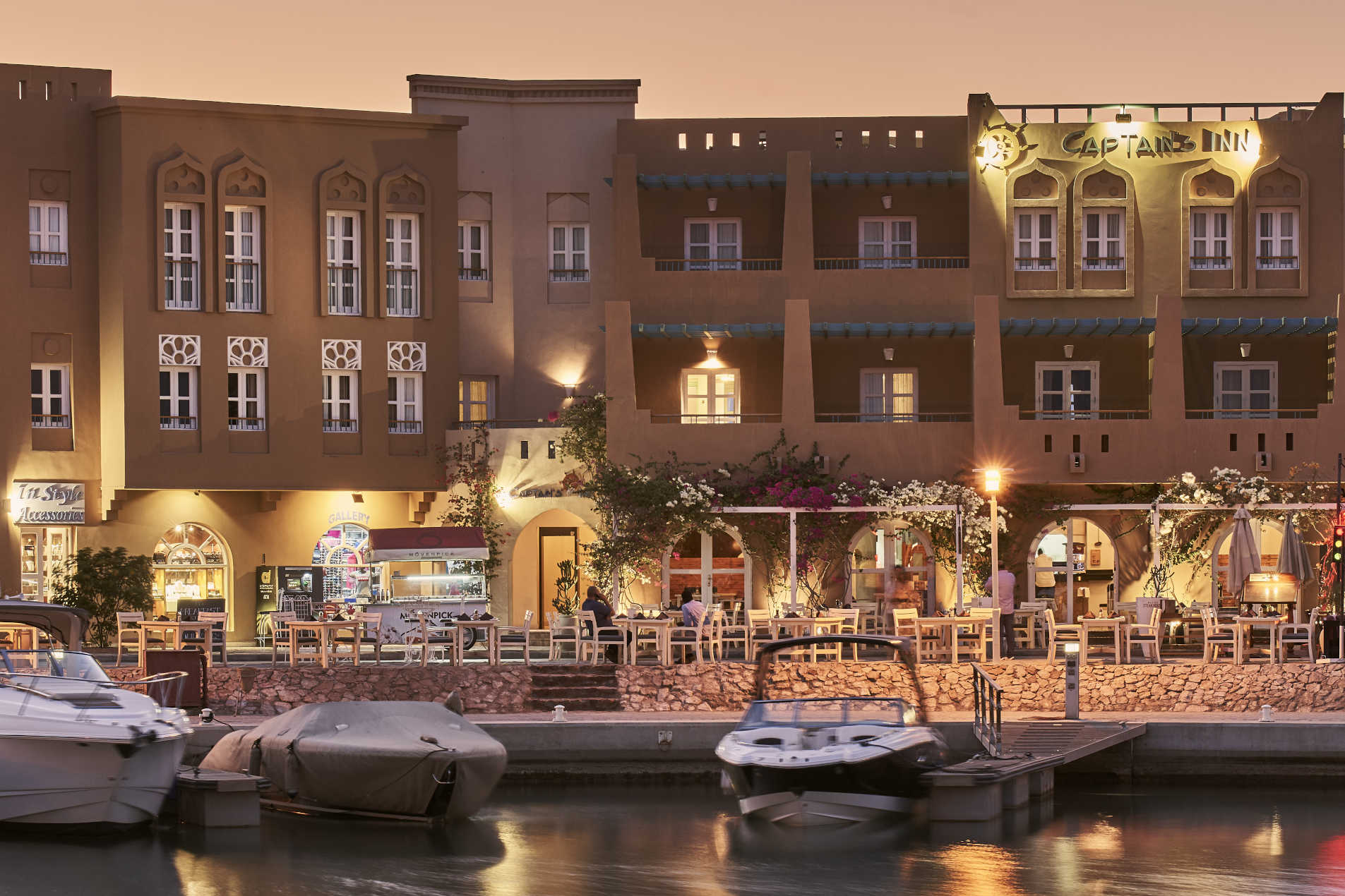 Night time exterior view of Captains in Hotel El Gouna from the marina side showing Hotel entrance & Marina steakhouse