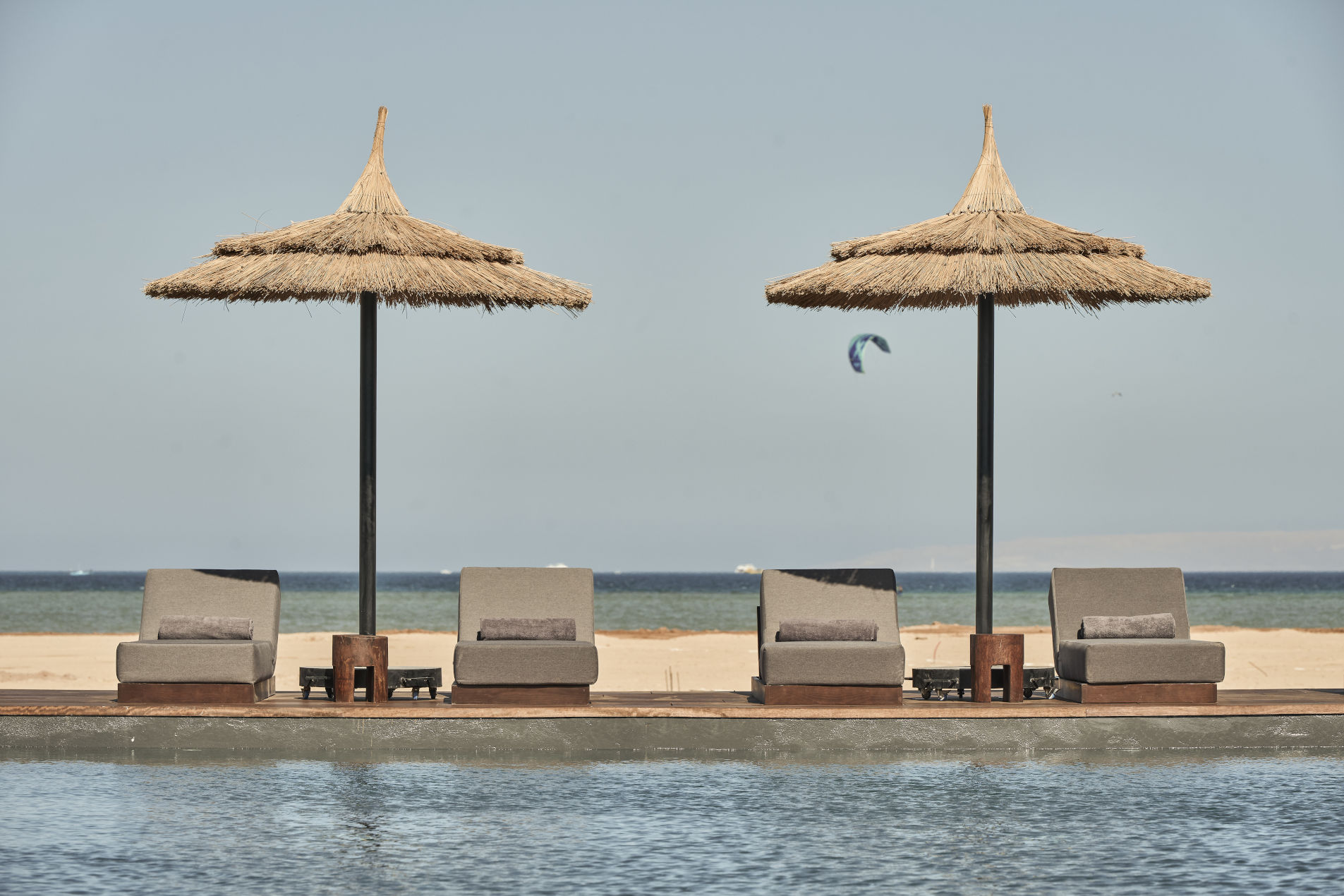 Casa Cook Hotel El Gouna Red Sea Pool Chaise Lounge and Kites on the Beach