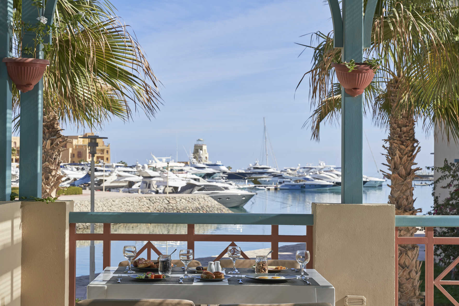 Breakfast at Mosaique hotel restaurant terrace with the fresh breeze of Red Sea and El Gouna Marina view