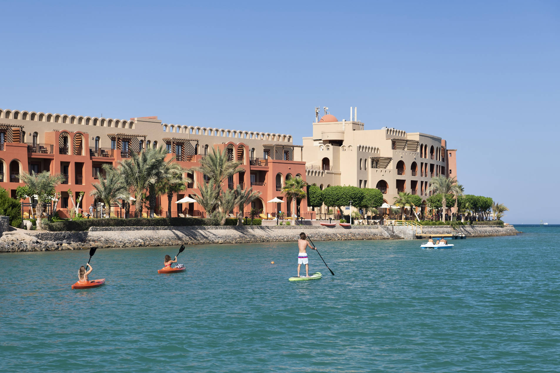 Paddle boarding and kayaking in El Gouna Abu Tig Marina in front of Ocean view Hotel facade