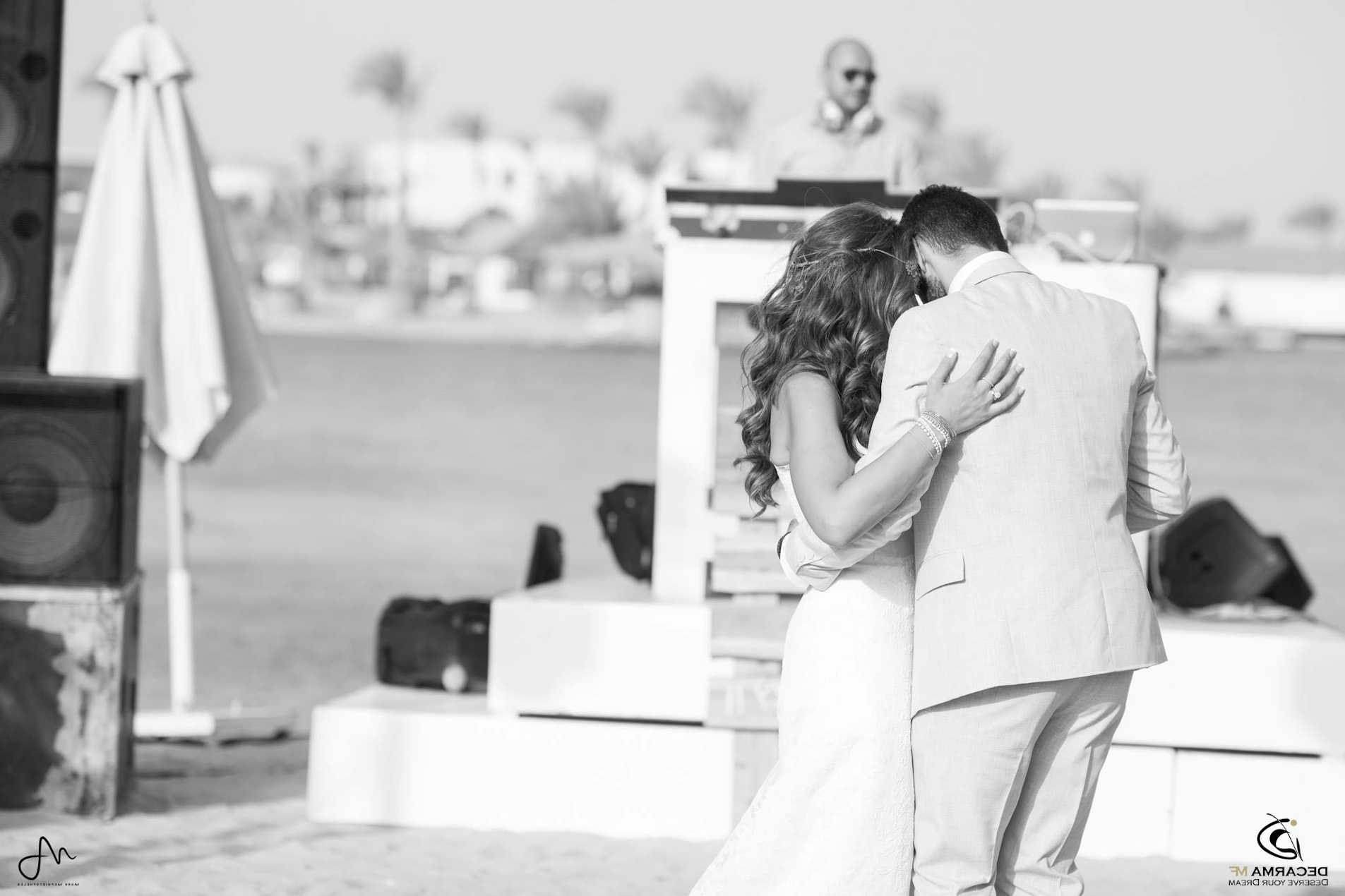 A groom and a bride are dancing in their wedding day at the luxury wedding venue at Ancient Sands Resort in El Gouna Red Sea