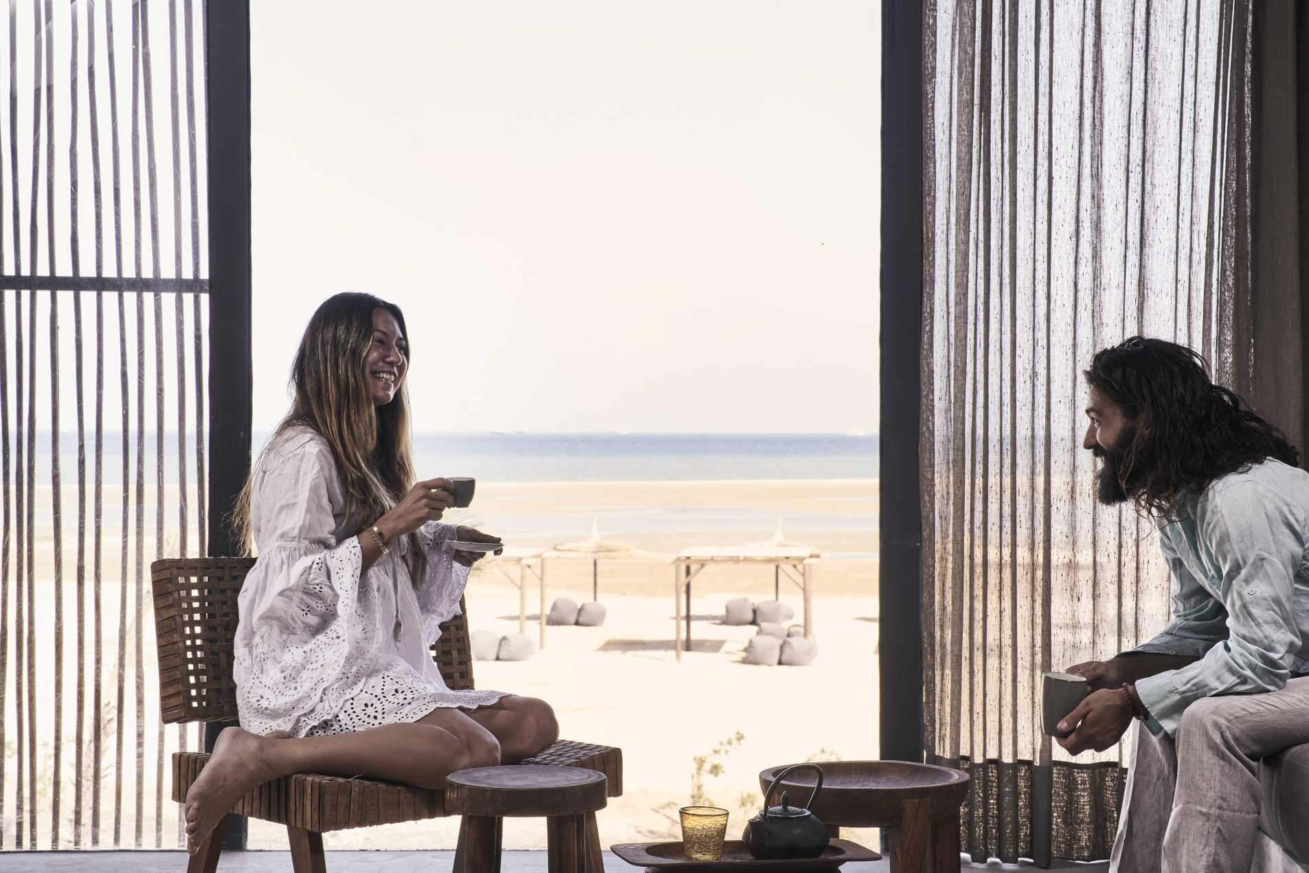 A lady and a guy laughing at Casa Cook Hotel room in El Gouna with Red Sea view of the room