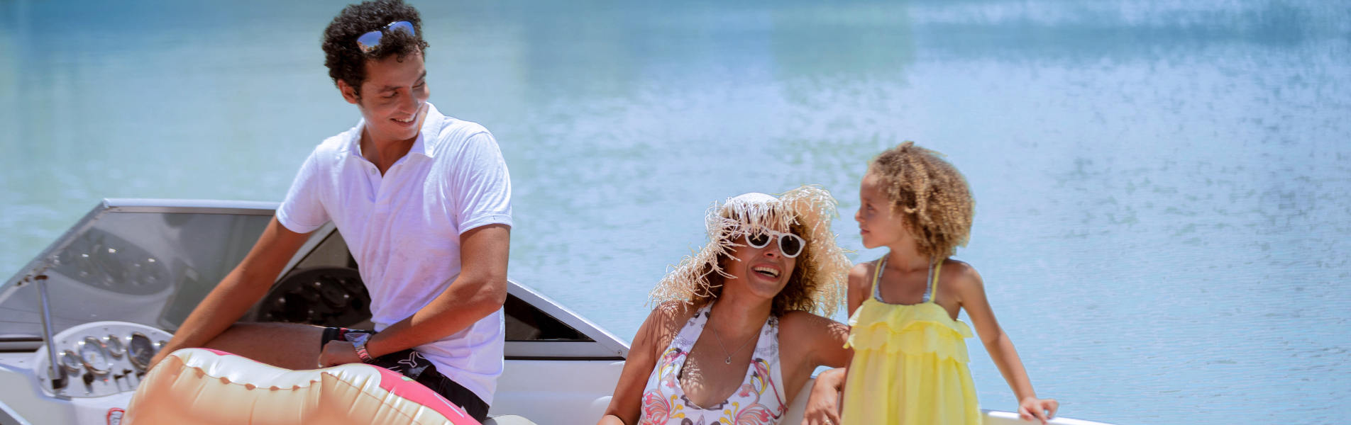 family having fun together in a boat at red sea el gouna town