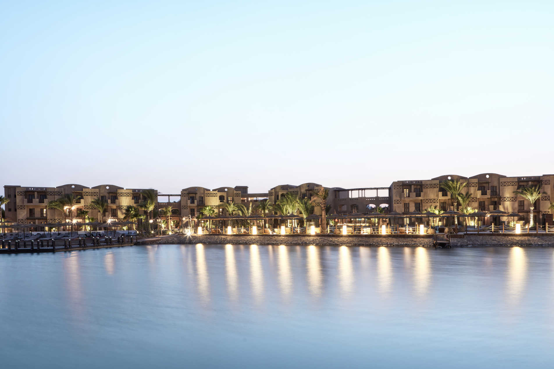 The overview of cooks club hotel in El Gouna Egypt during the sunset with a view to Red Sea lagoons and lights