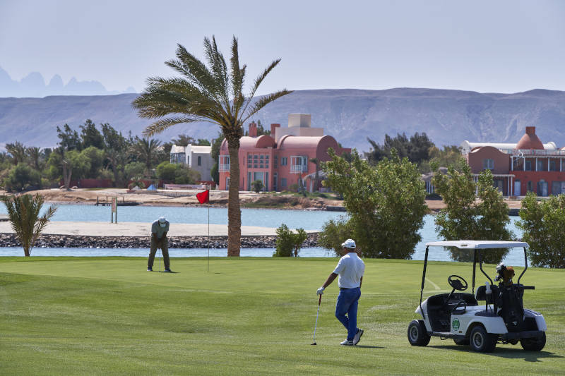 a golfer playing with a view of water pool at steigenberger golf resort el gouna