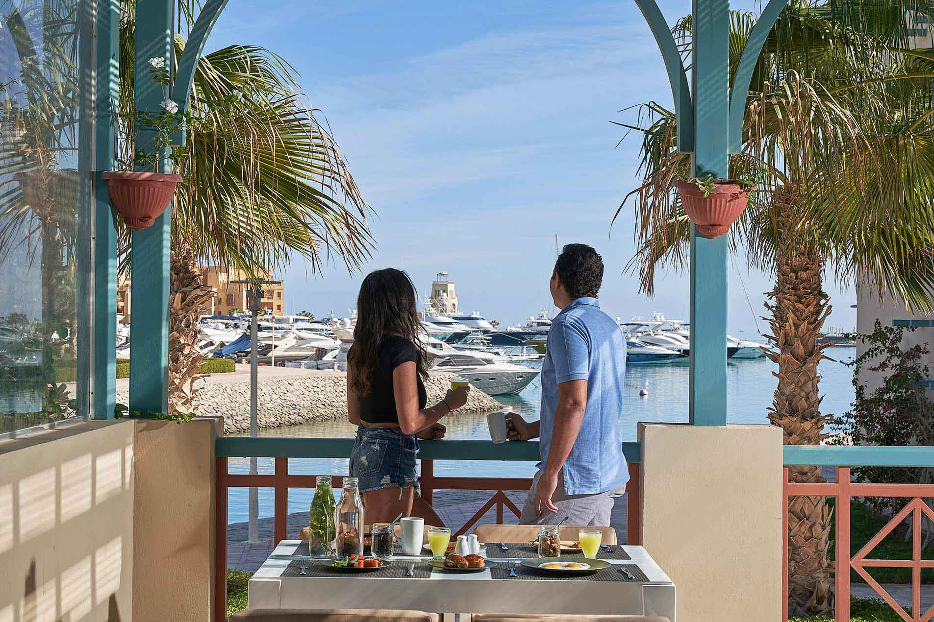 couple overviewing El Gouna marina from restaurant terrace