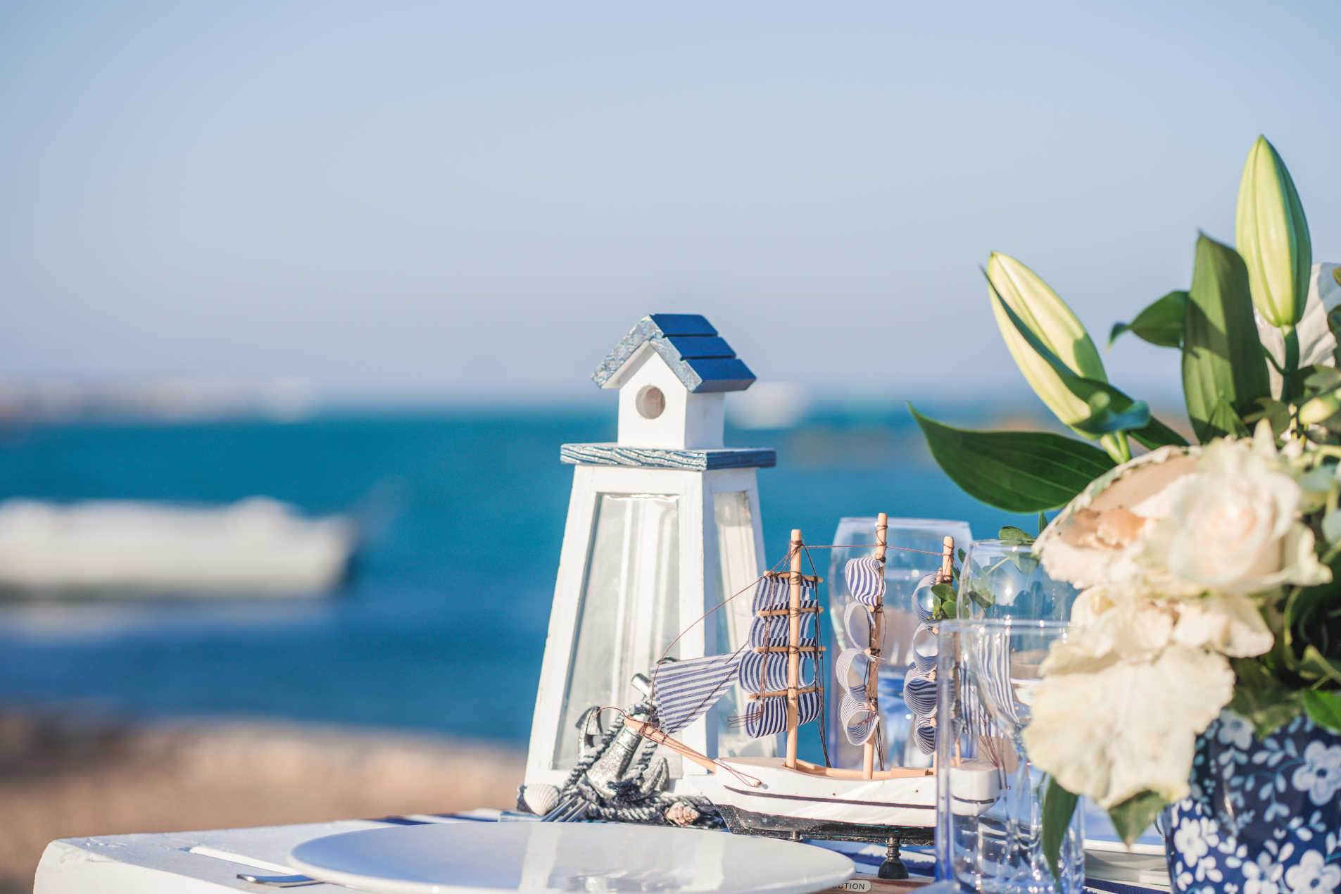 Beach wedding decoration with blue lighthouse in front of Red Sea in Egypt